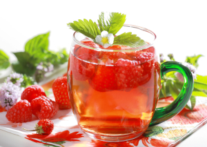 Refreshing summer ice tea with fruits and herbs